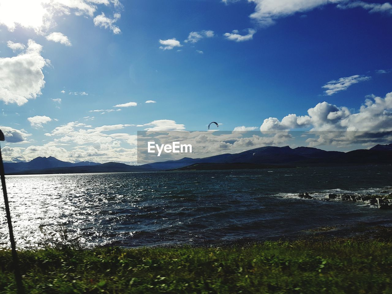 sky, cloud - sky, water, scenics - nature, tranquil scene, mountain, tranquility, beauty in nature, nature, day, sea, no people, land, bird, vertebrate, non-urban scene, outdoors, animal themes