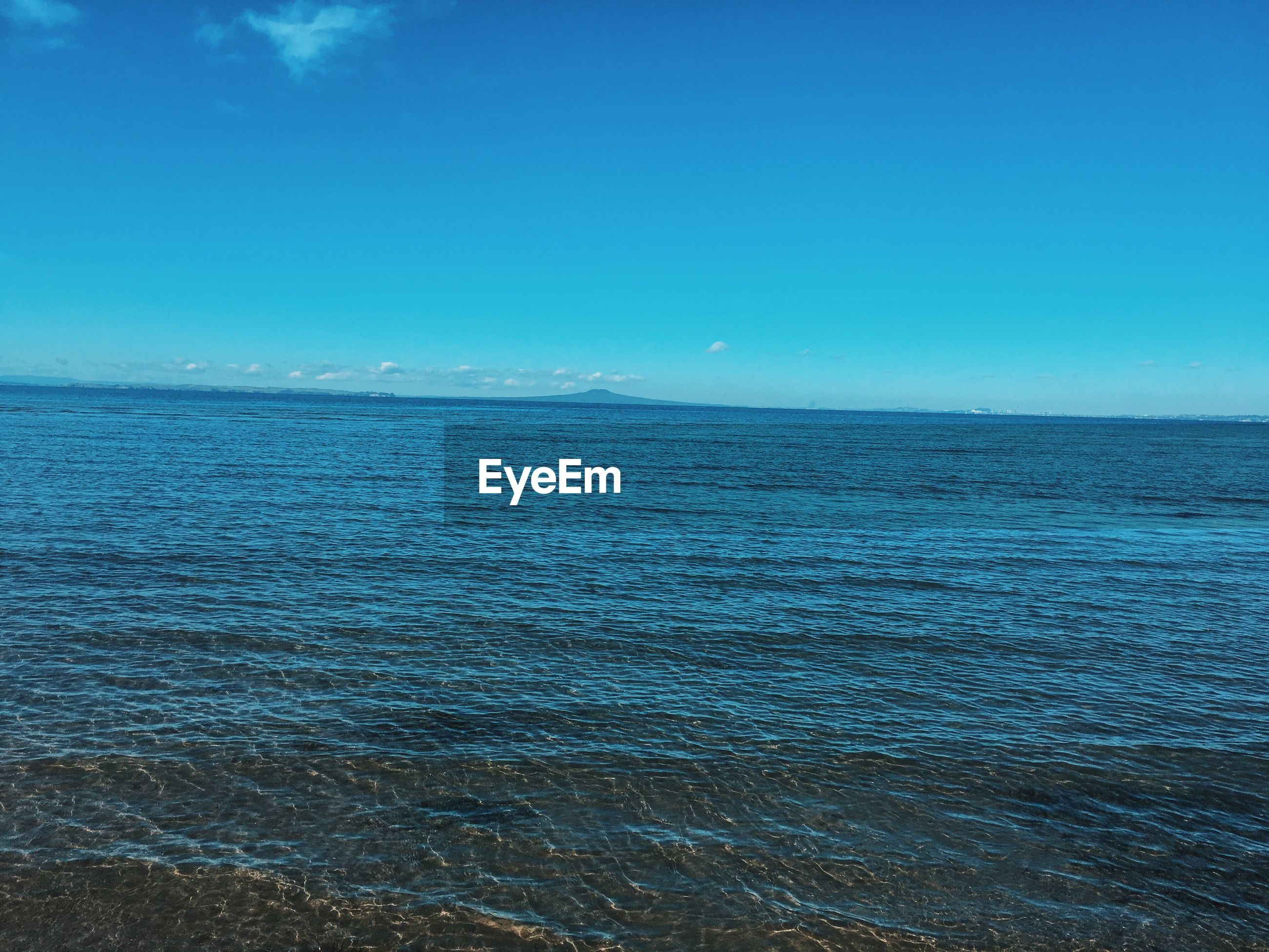 sea, water, blue, horizon over water, scenics, tranquil scene, tranquility, beauty in nature, seascape, idyllic, nature, rippled, waterfront, calm, non-urban scene, outdoors, sky, day, shore, remote, no people, ocean, majestic, wave