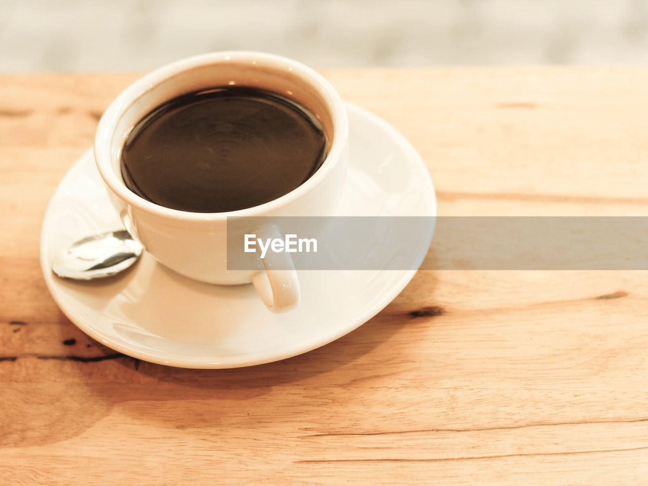 drink, refreshment, coffee, food and drink, coffee - drink, cup, mug, table, coffee cup, still life, saucer, crockery, freshness, close-up, indoors, wood - material, food, no people, focus on foreground, high angle view, non-alcoholic beverage, tea cup