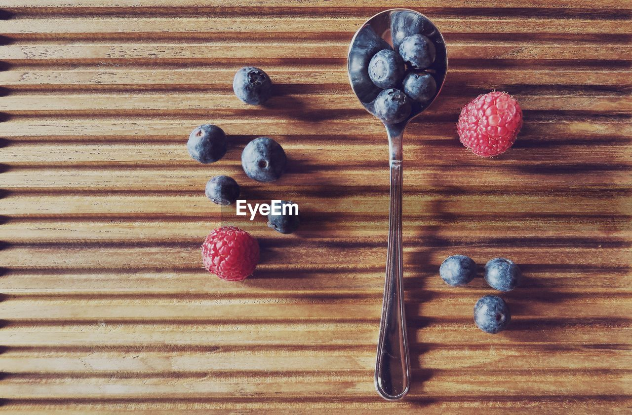 High angle view of blueberries and raspberries on table