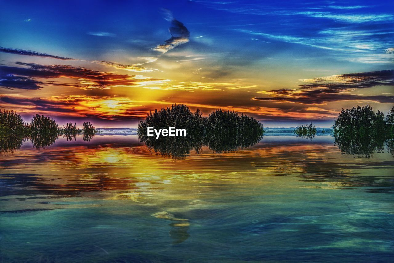 water, tree, cloud - sky, sky, sunset, beauty in nature, nature, tranquility, tranquil scene, reflection, scenics, waterfront, no people, outdoors, lake, day