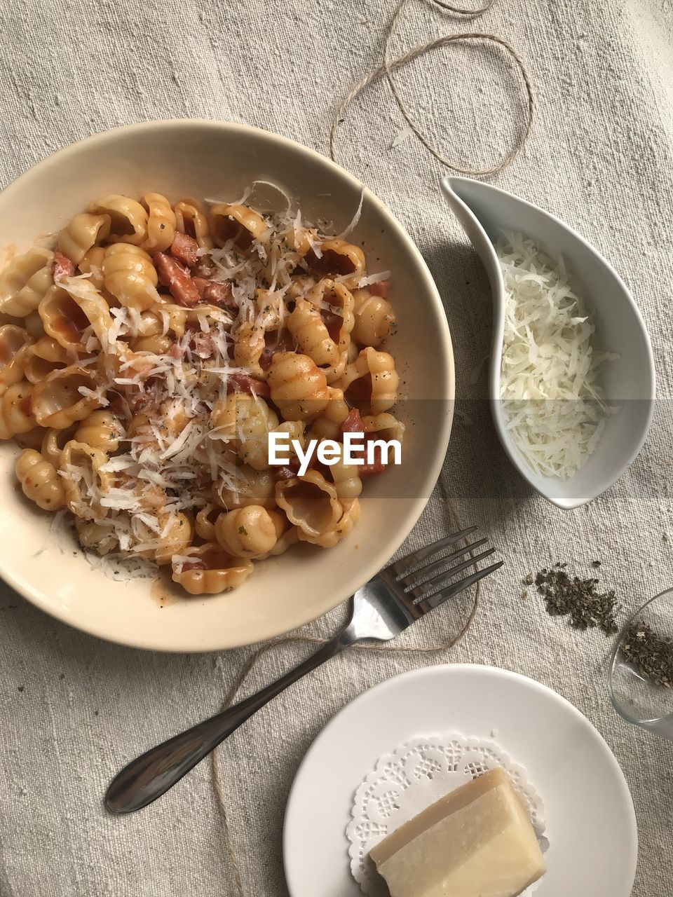 food and drink, food, ready-to-eat, freshness, eating utensil, kitchen utensil, table, bowl, healthy eating, wellbeing, directly above, indoors, meal, spoon, pasta, high angle view, italian food, no people, still life, plate, breakfast, spaghetti
