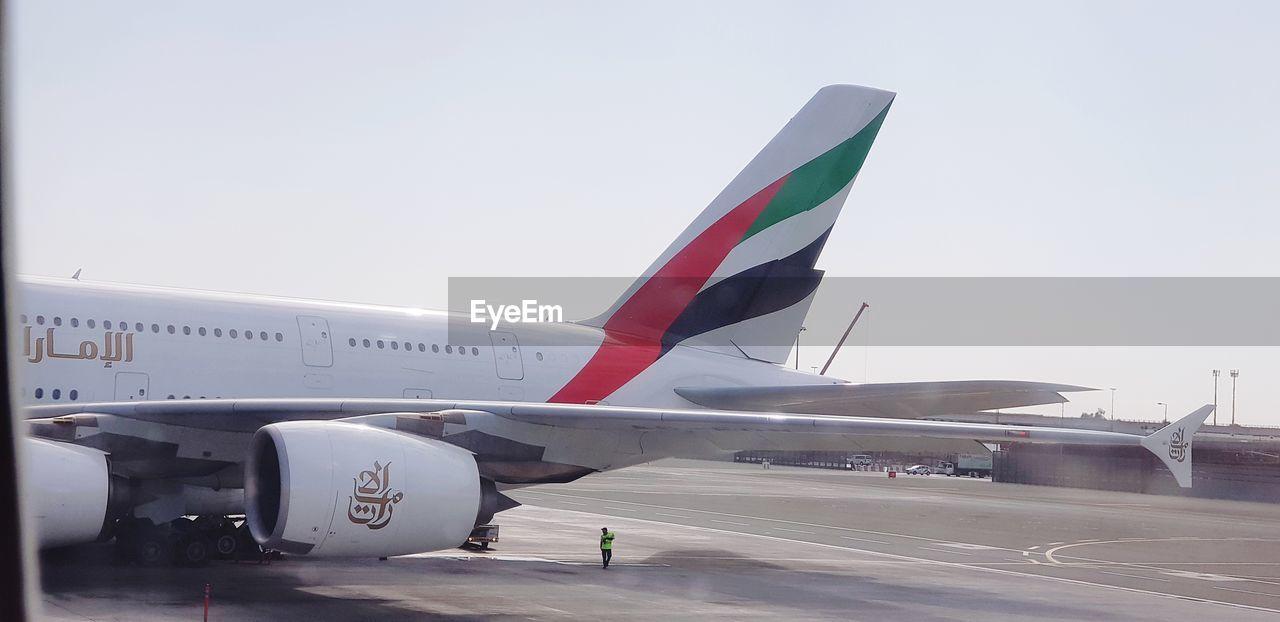AIRPORT RUNWAY AGAINST SKY
