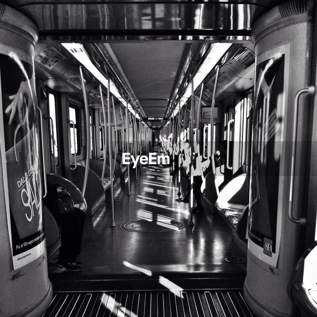 transportation, train - vehicle, public transportation, rail transportation, vehicle seat, mode of transport, subway train, indoors, illuminated, real people, commuter train, day