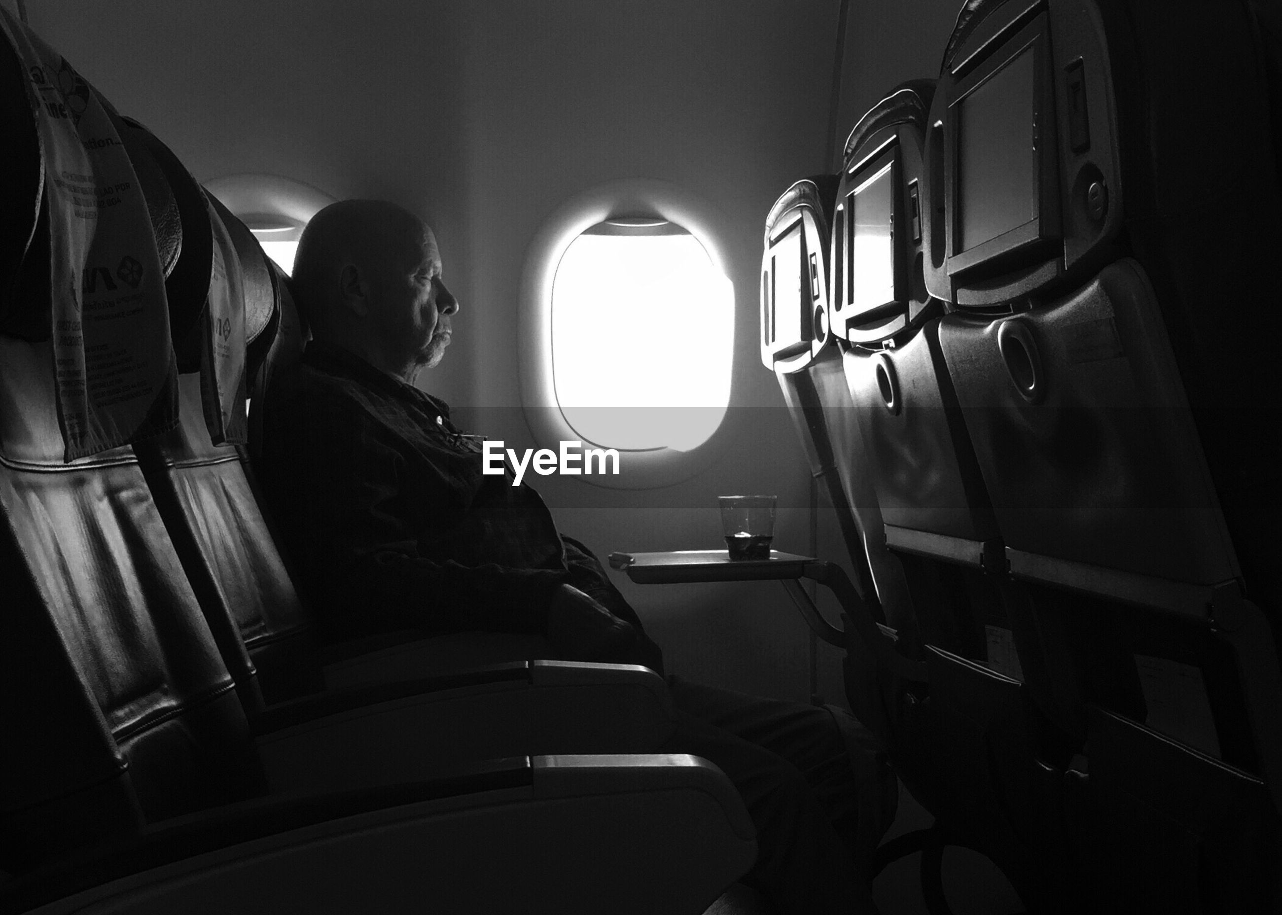 vehicle interior, transportation, sitting, vehicle seat, airplane, journey, travel, window, passenger, seat, indoors, one person, mode of transport, public transportation, air vehicle, airplane seat, flying, women, young women, day, sky, young adult, people