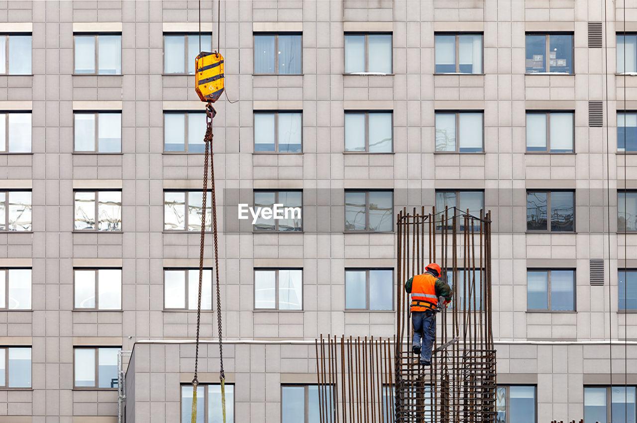 MEN WORKING ON BUILDING