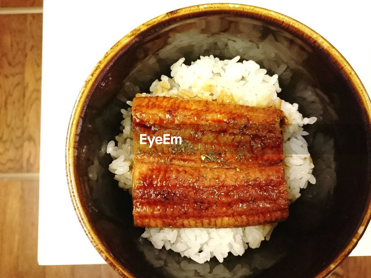 Directly Above Shot Of Kabayaki With Rice Served In Bowl On Table