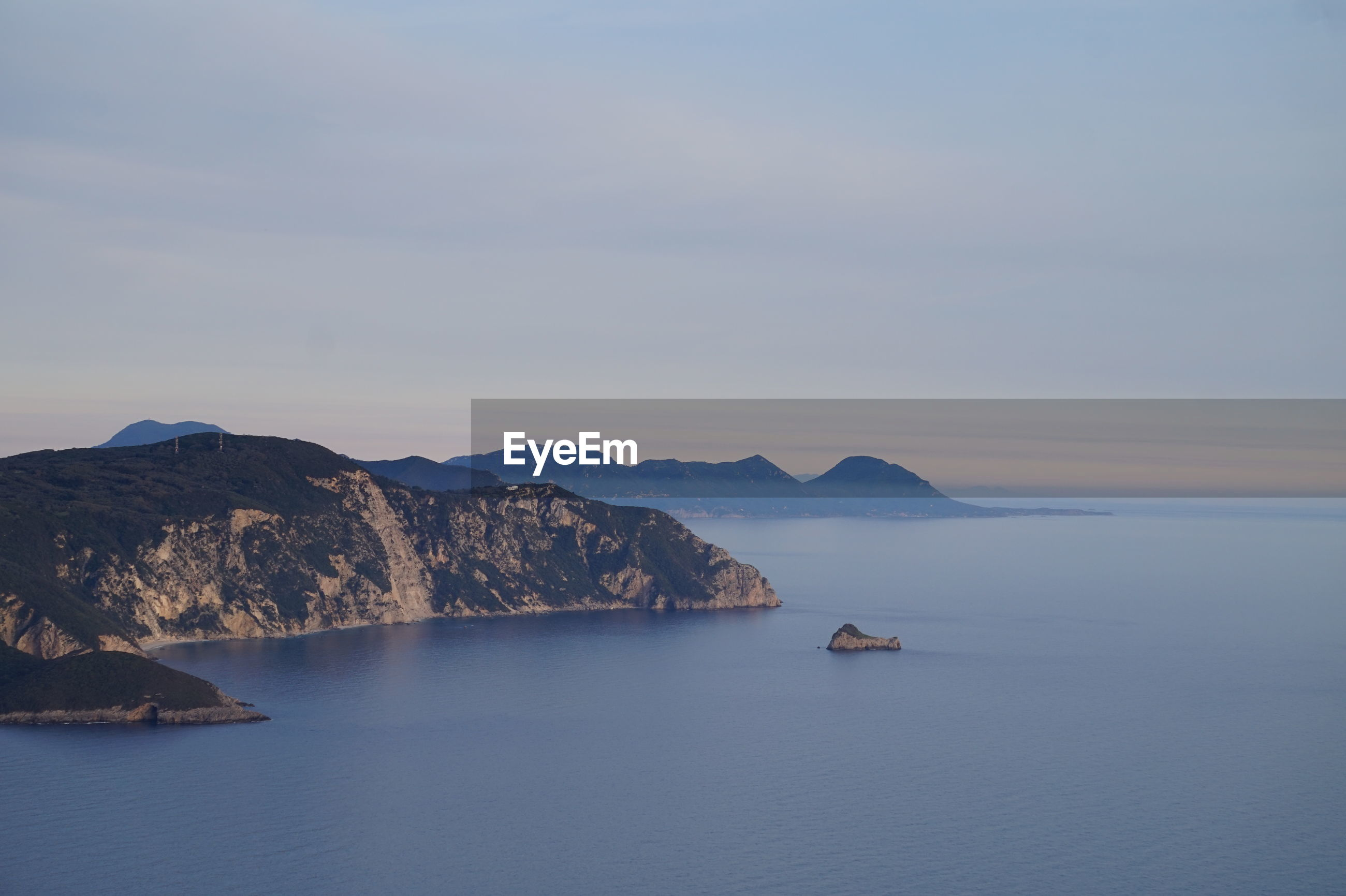 SCENIC VIEW OF SEA AND ROCK FORMATION AGAINST SKY