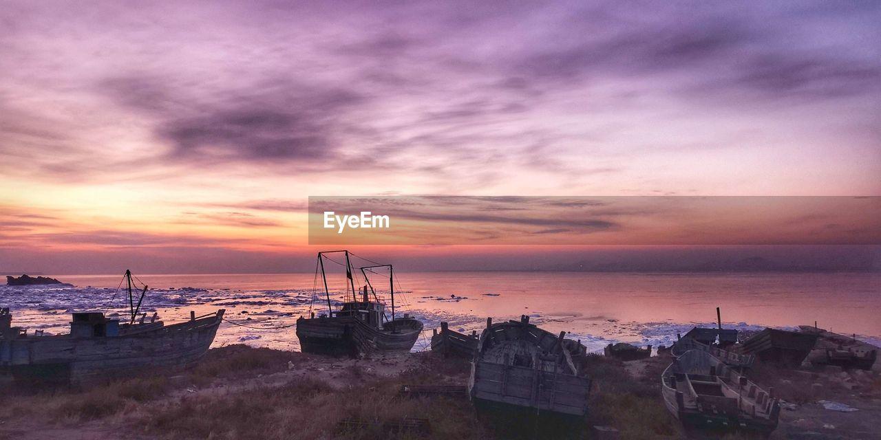 sunset, sky, sea, water, cloud - sky, horizon over water, beauty in nature, scenics - nature, beach, nautical vessel, nature, horizon, land, no people, transportation, orange color, tranquility, tranquil scene, idyllic, outdoors, purple