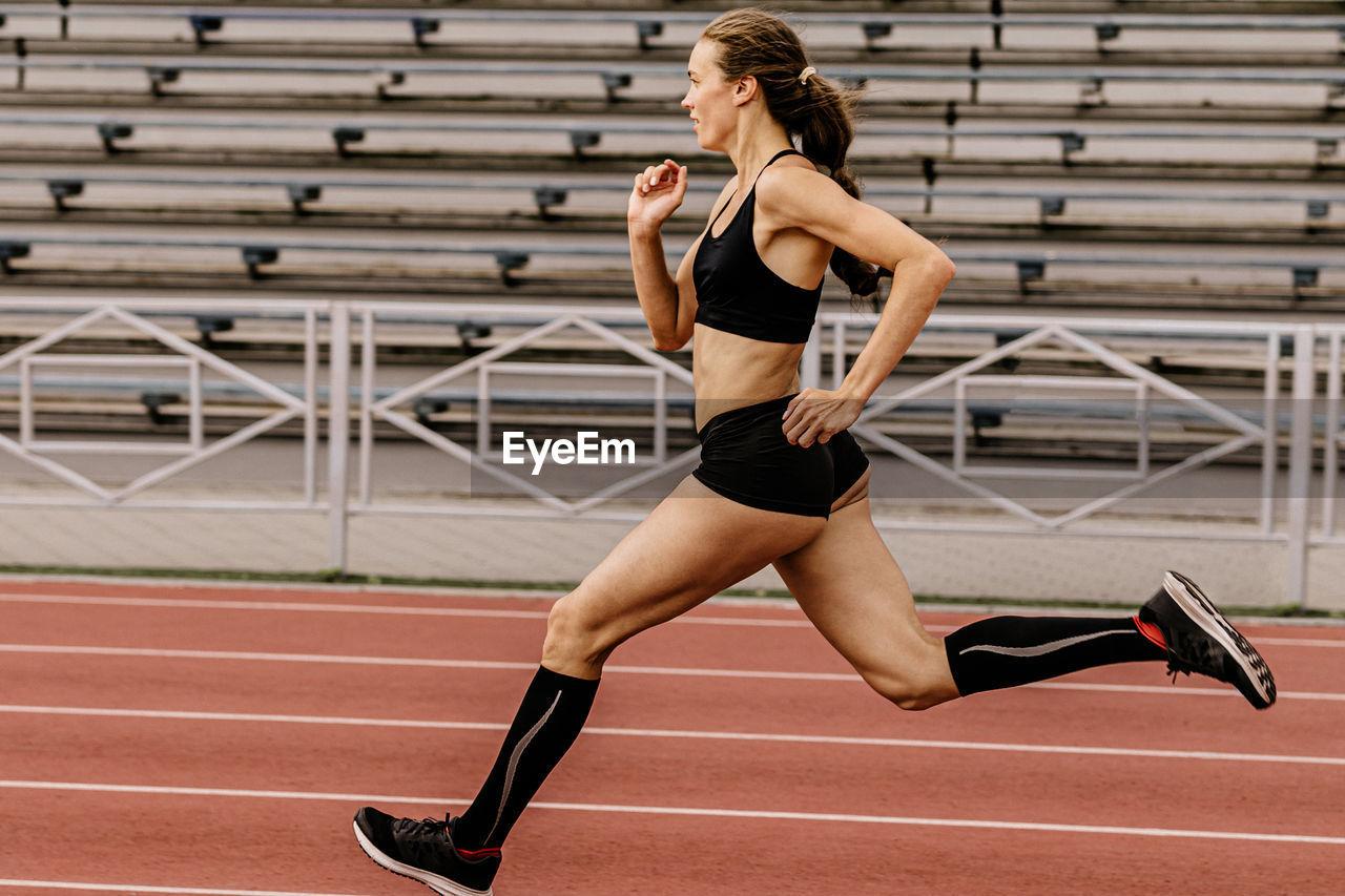 Full length of woman running on track