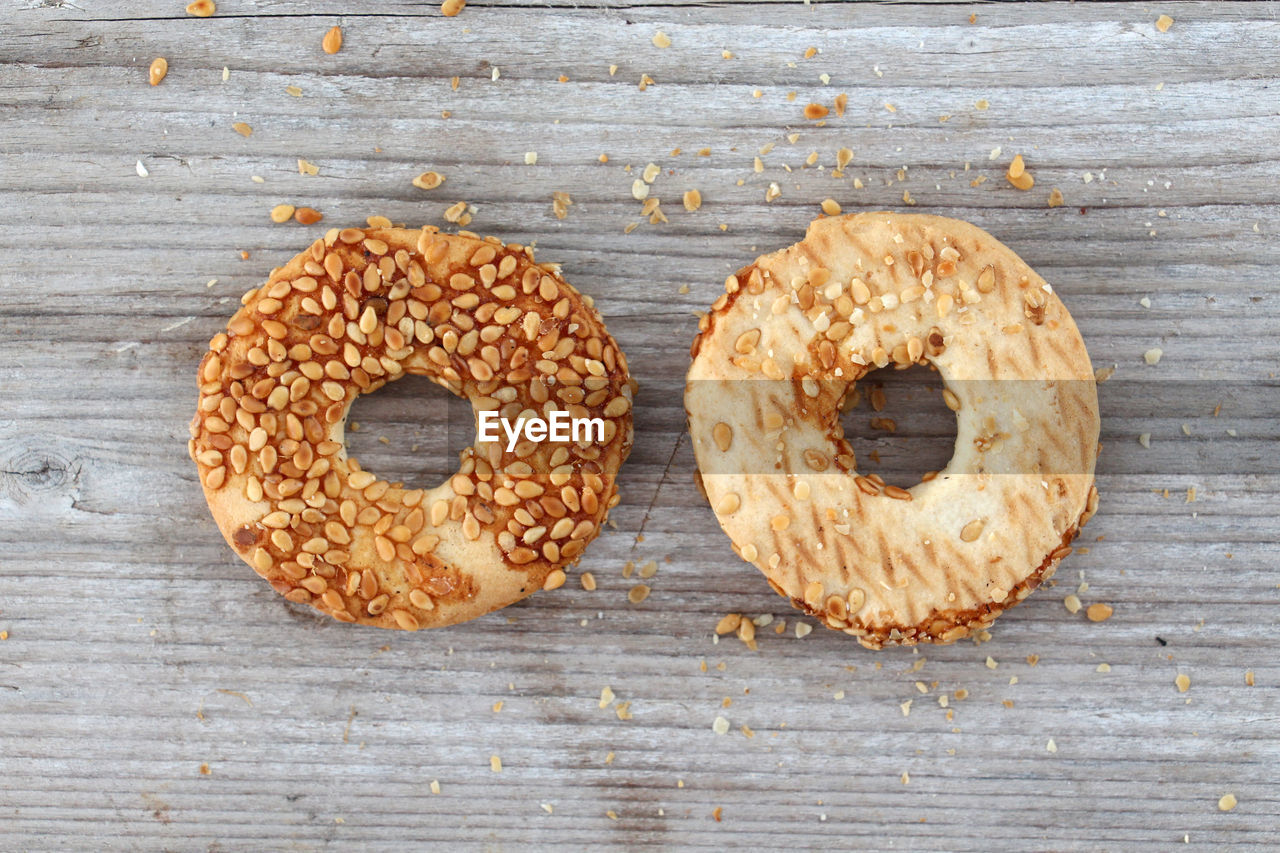 food, food and drink, wood - material, donut, baked, no people, freshness, indoors, table, high angle view, sweet food, ready-to-eat, close-up, day