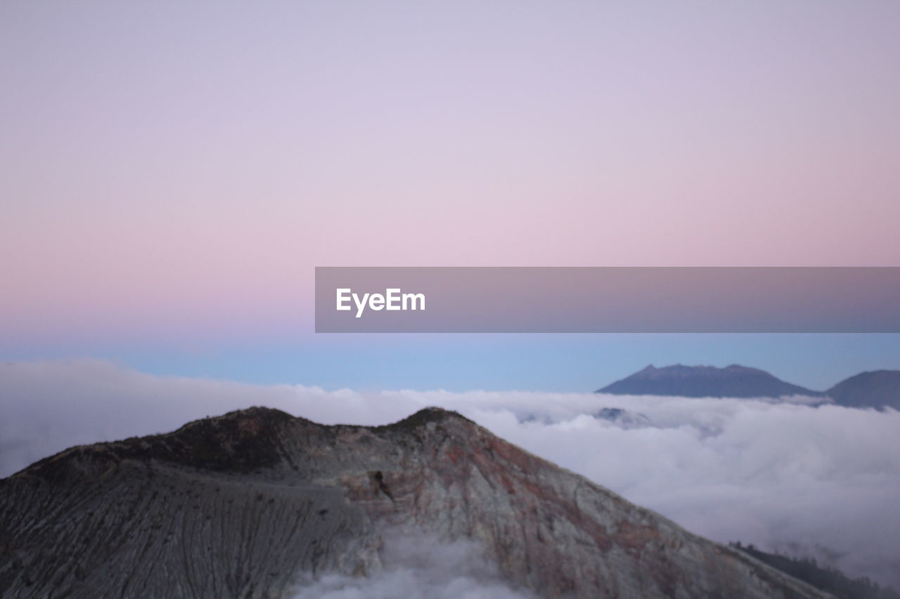 sky, scenics - nature, mountain, beauty in nature, tranquil scene, tranquility, sunset, copy space, non-urban scene, nature, cloud - sky, idyllic, no people, environment, outdoors, remote, landscape, cold temperature, geology, volcanic crater