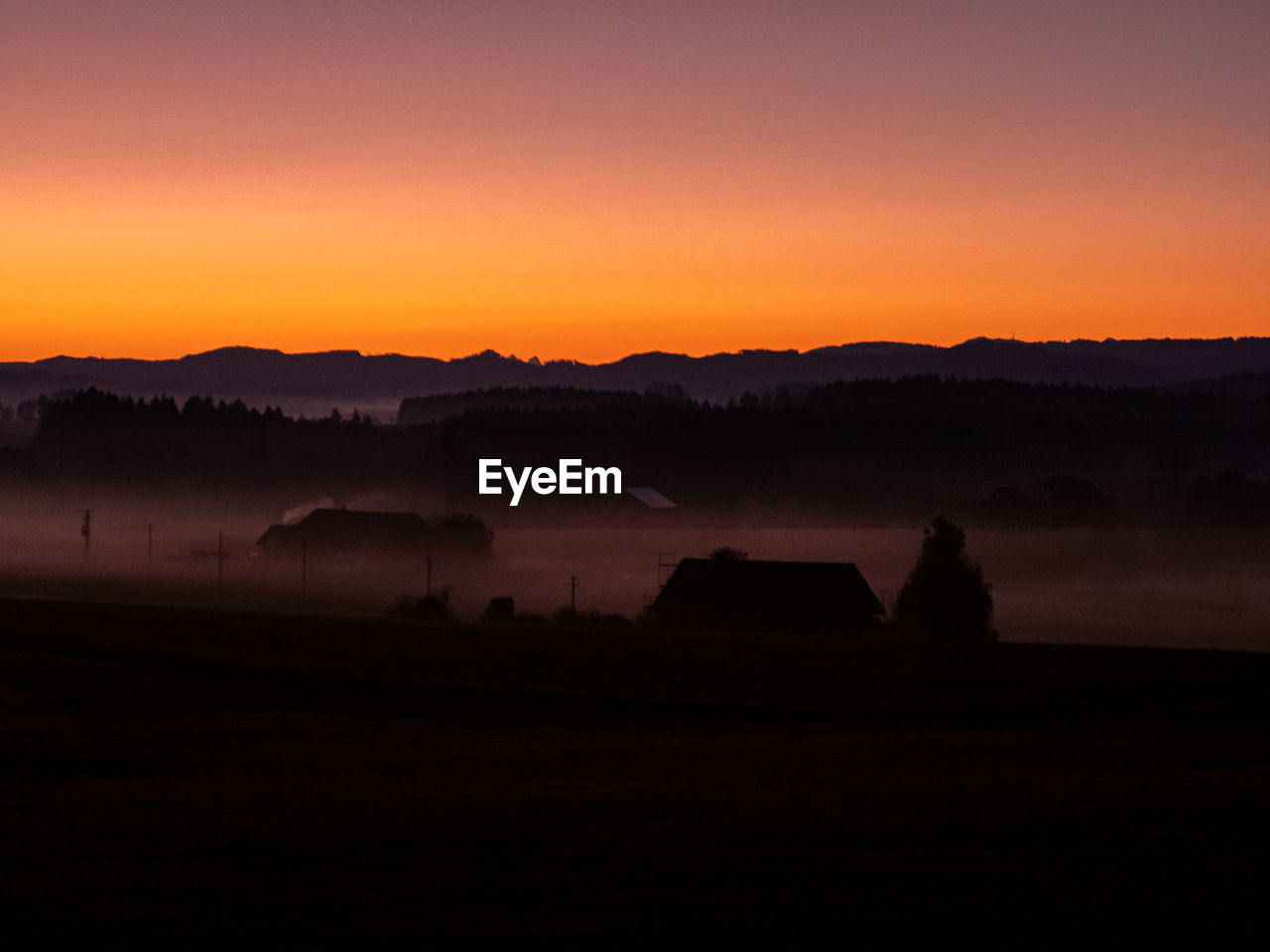 sky, beauty in nature, scenics - nature, tranquil scene, tranquility, sunset, orange color, landscape, environment, no people, silhouette, copy space, non-urban scene, nature, idyllic, clear sky, mountain, outdoors, land, hazy