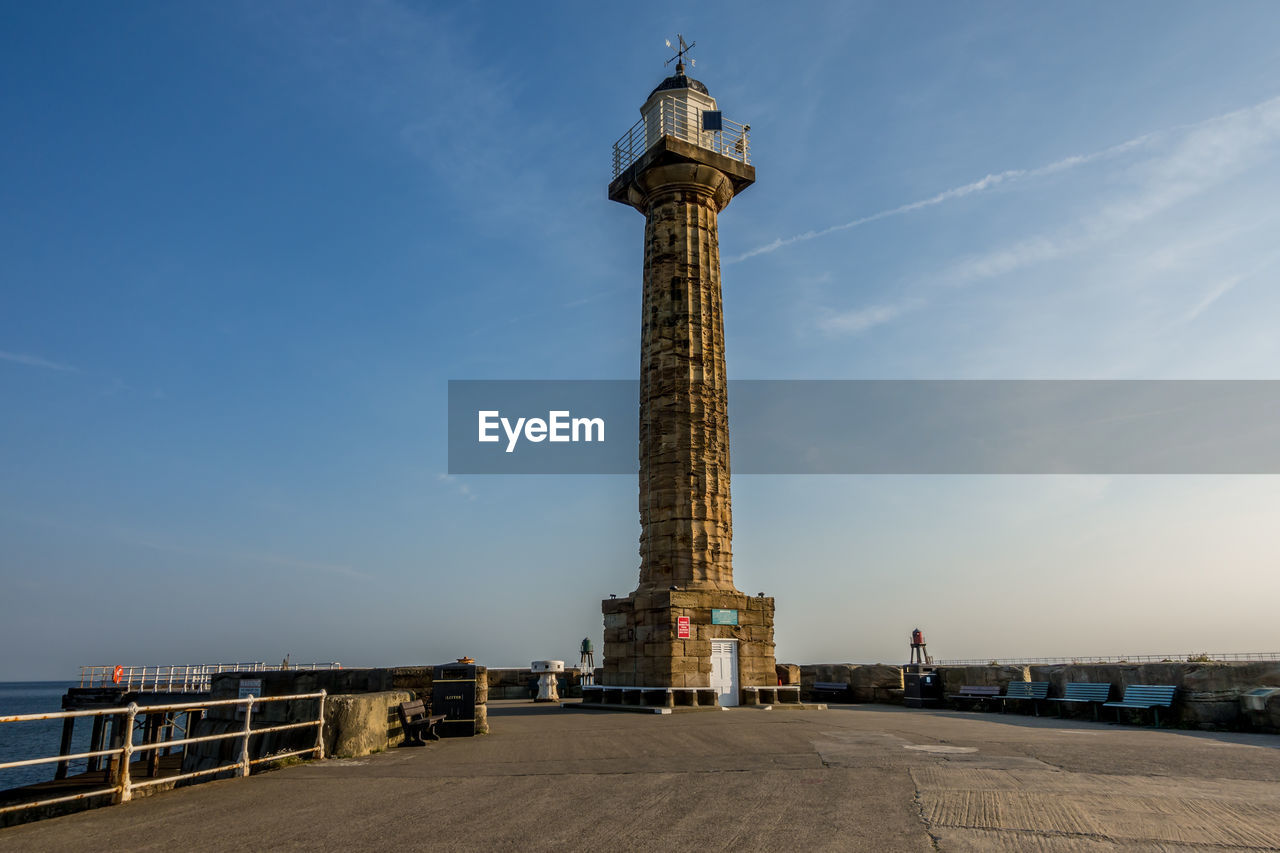 architecture, sky, built structure, travel destinations, tower, travel, tall - high, tourism, history, building exterior, the past, city, nature, memorial, water, monument, cloud - sky, building, low angle view, no people, architectural column, outdoors