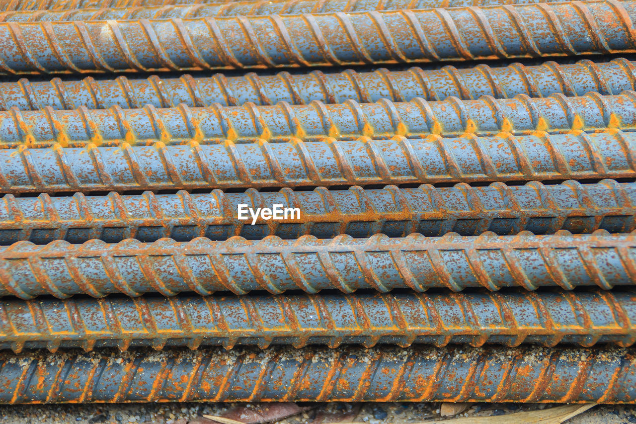 backgrounds, full frame, rusty, no people, pattern, metal, close-up, day, old, weathered, stack, in a row, large group of objects, repetition, abundance, dirt, outdoors, textured, high angle view, dirty, roof tile, corrugated