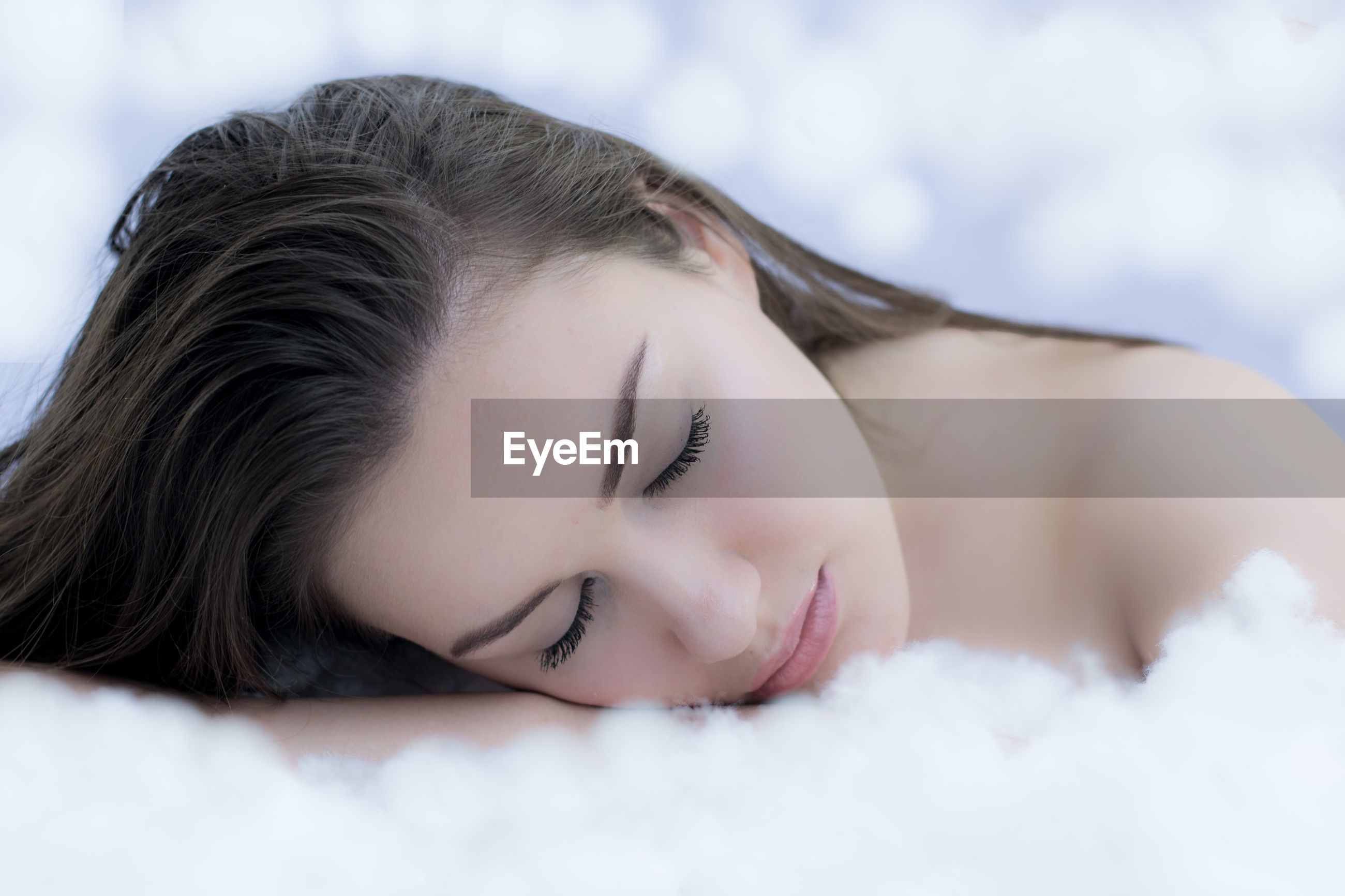 Close-up of teenage girl sleeping on bed