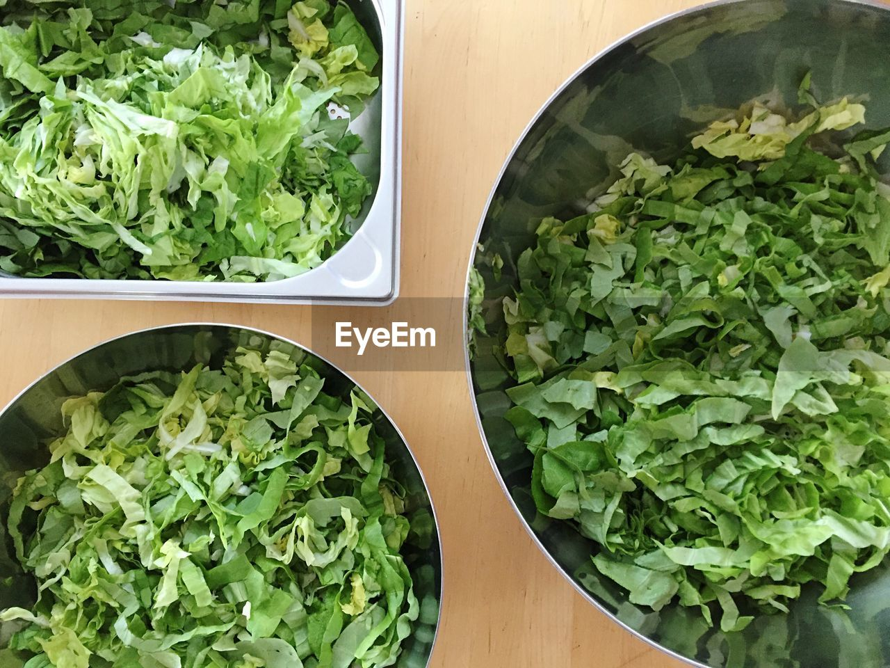 food and drink, food, healthy eating, indoors, green color, freshness, no people, vegetable, leaf, salad, close-up, bowl, directly above, lettuce, ready-to-eat, day