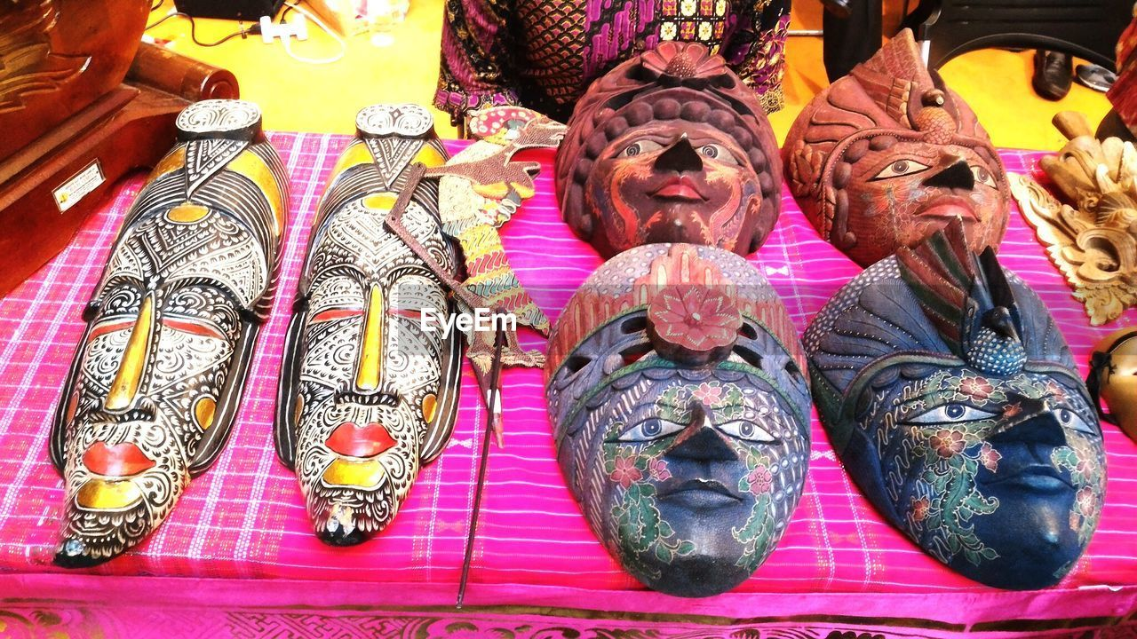 High Angle View Of Various Masks Displayed At Market Stall