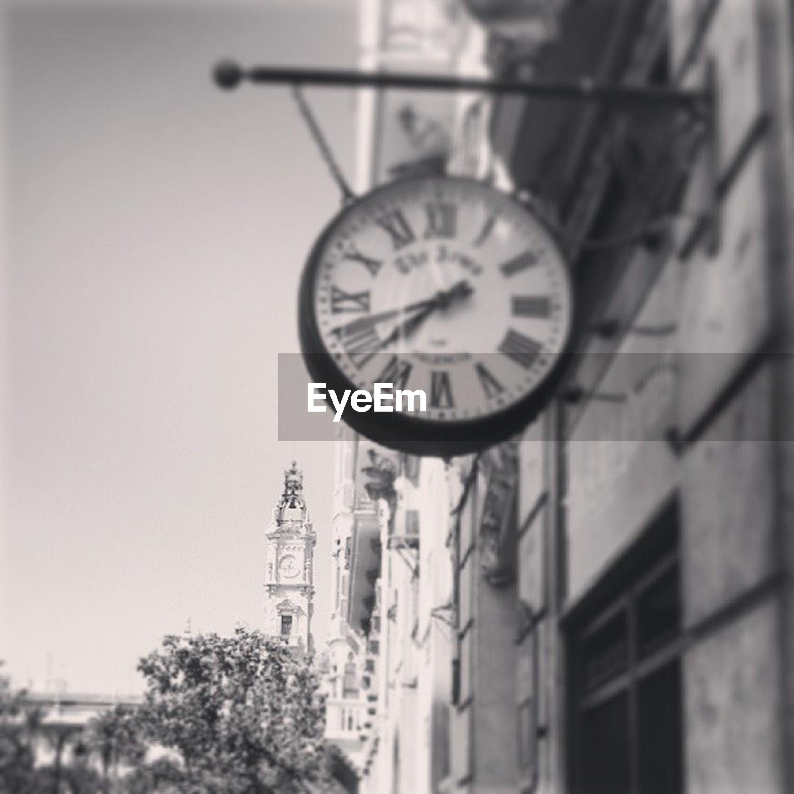 time, clock, architecture, built structure, building exterior, low angle view, clock tower, clear sky, clock face, number, day, circle, outdoors, no people, communication, tree, old-fashioned, sky, old, religion
