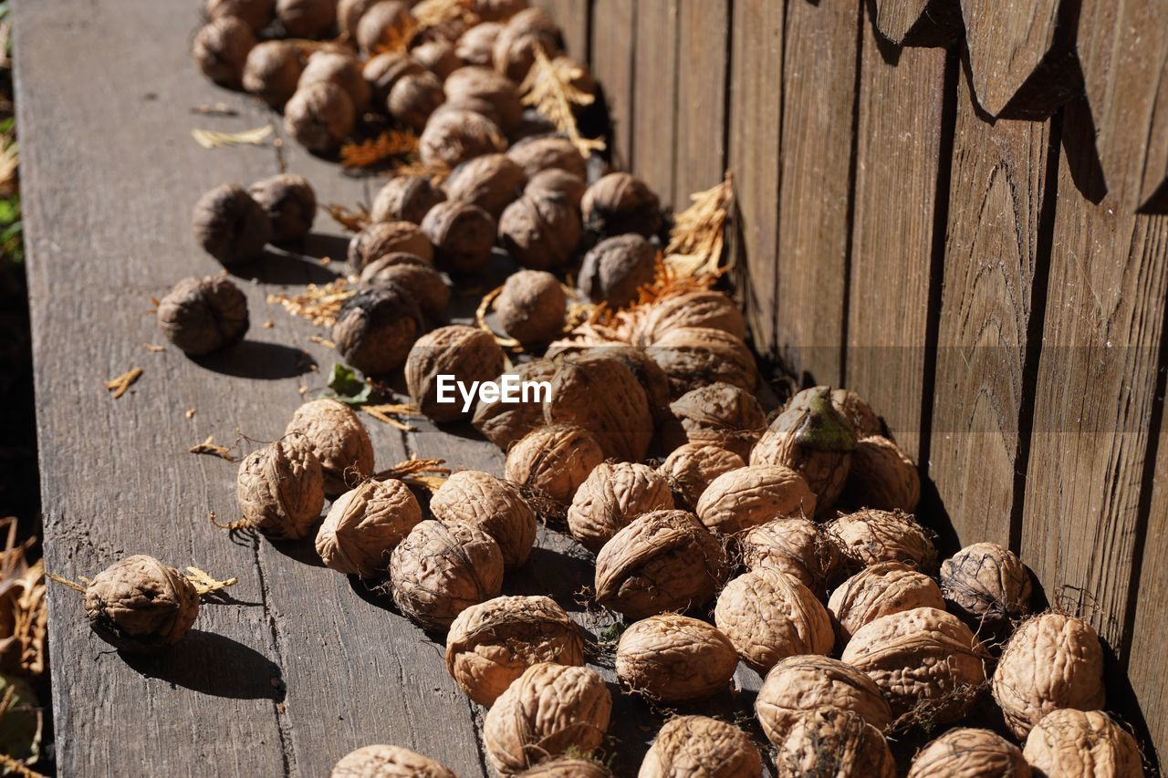 wood - material, food and drink, food, no people, freshness, day, table, high angle view, sunlight, large group of objects, still life, walnut, nut, close-up, healthy eating, nut - food, wellbeing, indoors, nature, brown
