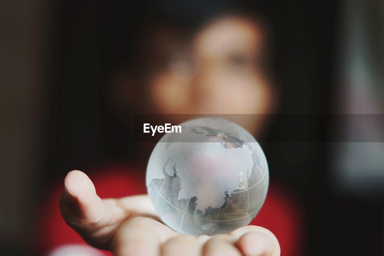Woman holding crystal globe