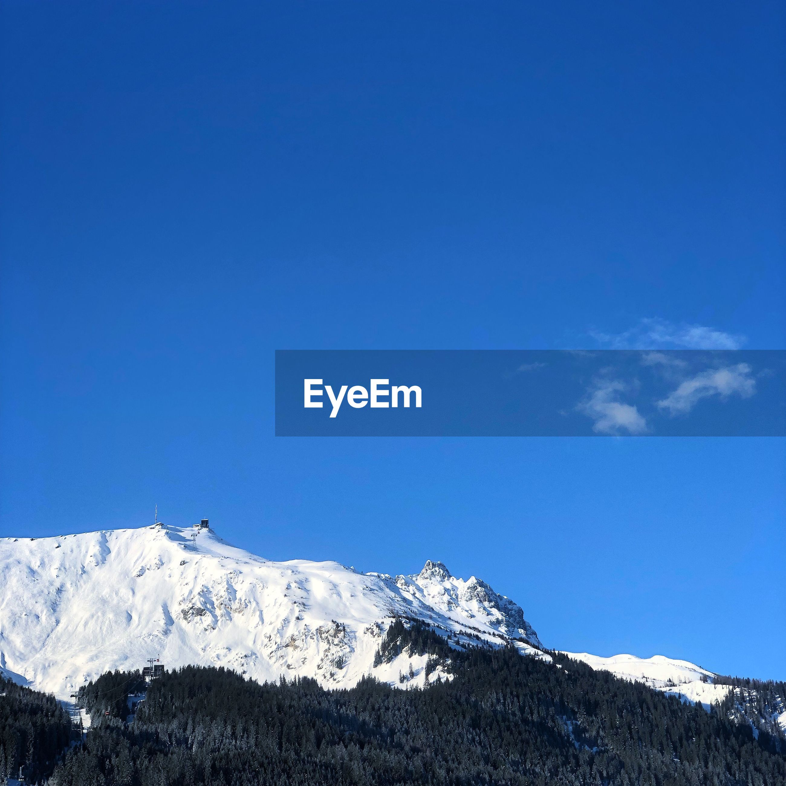 SNOWCAPPED MOUNTAIN AGAINST BLUE SKY