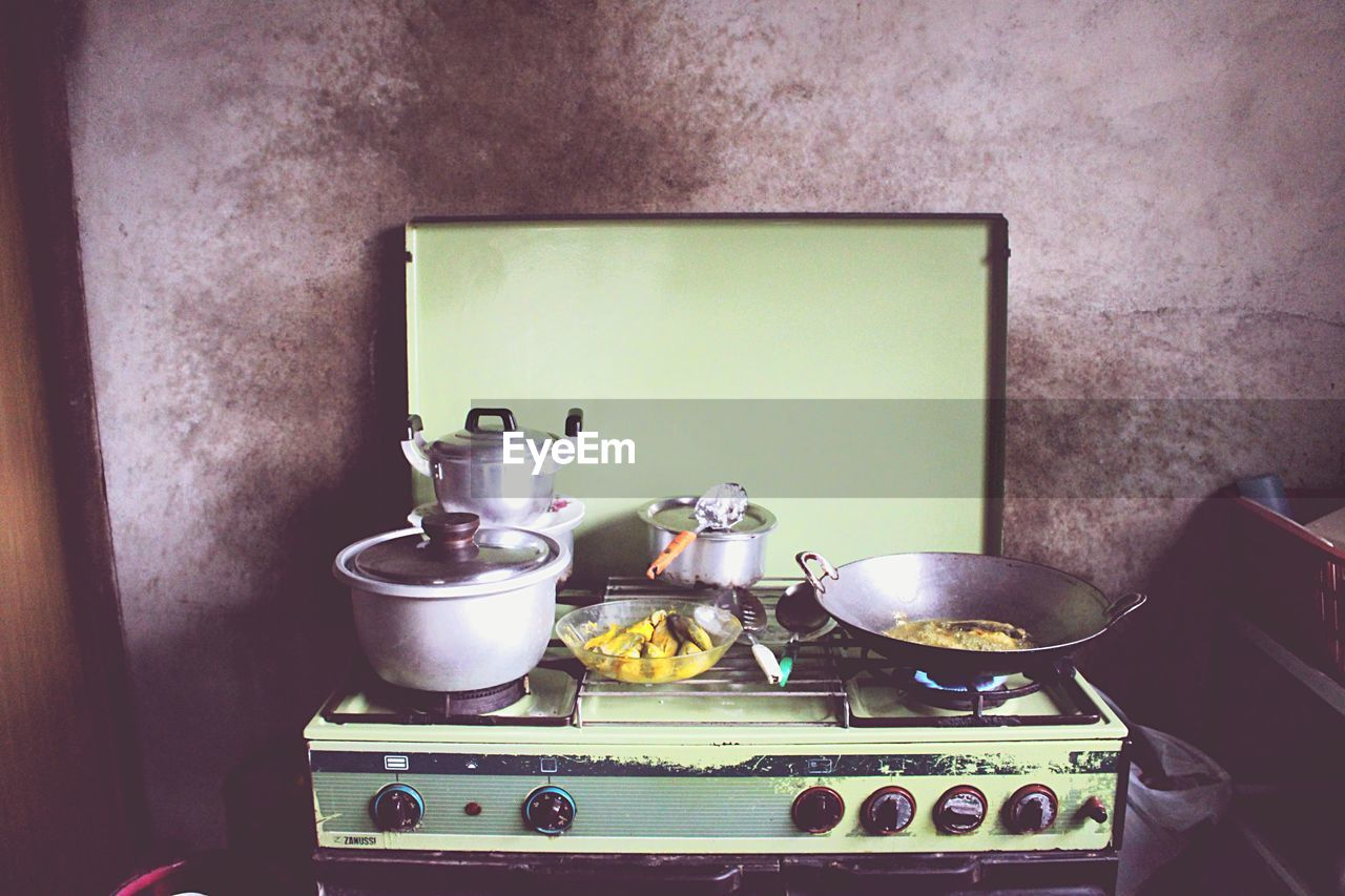 Food Cooking In Stove At Kitchen