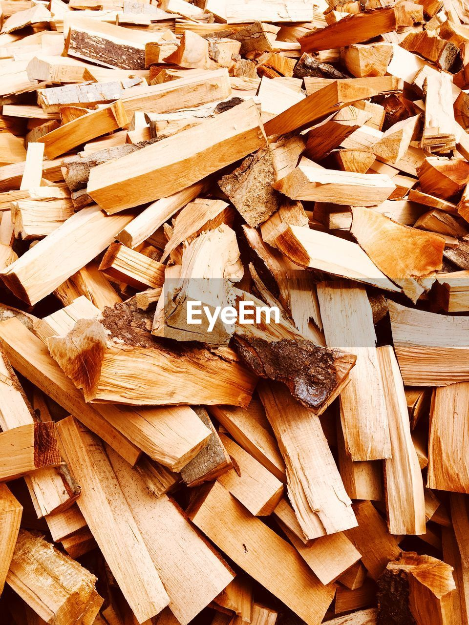wood - material, large group of objects, wood, full frame, timber, abundance, backgrounds, log, no people, heap, still life, brown, stack, tree, close-up, firewood, lumber industry, high angle view, forest, fossil fuel, chopped, woodpile
