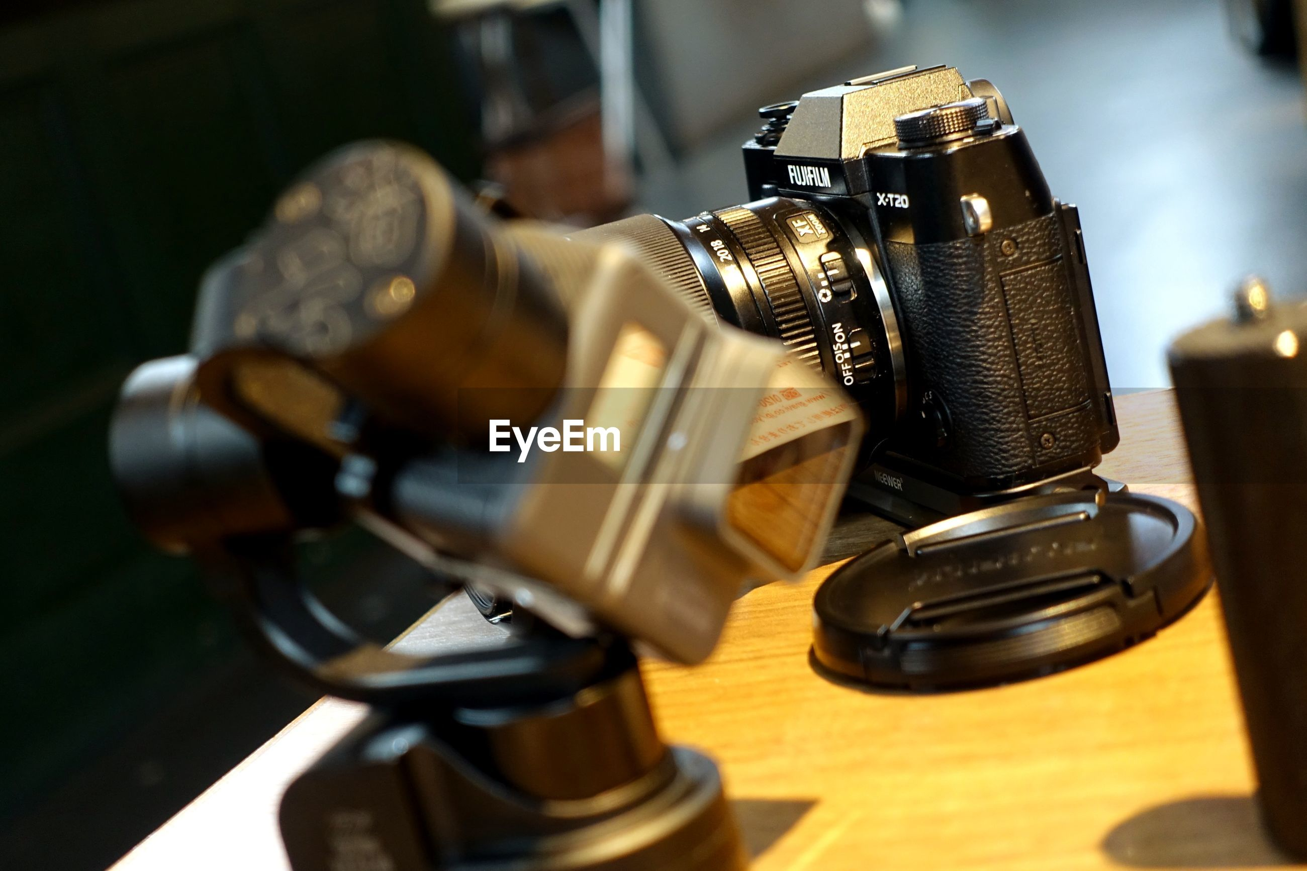 CLOSE-UP OF CAMERA ON TABLE AT NIGHTCLUB