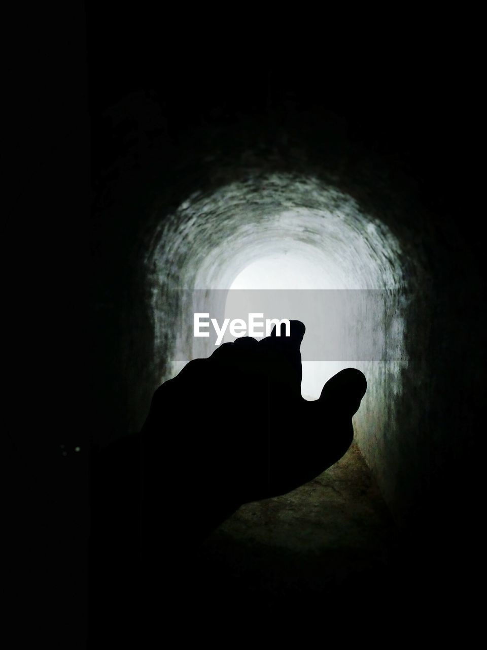 Silhouette Of Hand In Tunnel