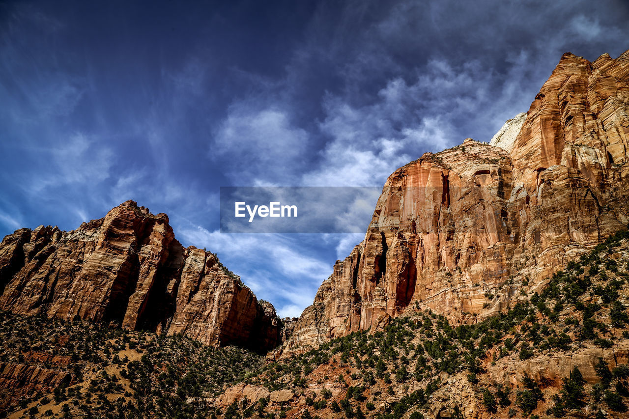 rock, cloud - sky, rock formation, sky, rock - object, scenics - nature, solid, tranquil scene, beauty in nature, mountain, non-urban scene, tranquility, geology, nature, physical geography, low angle view, remote, mountain range, no people, travel, formation, arid climate, outdoors, climate, eroded