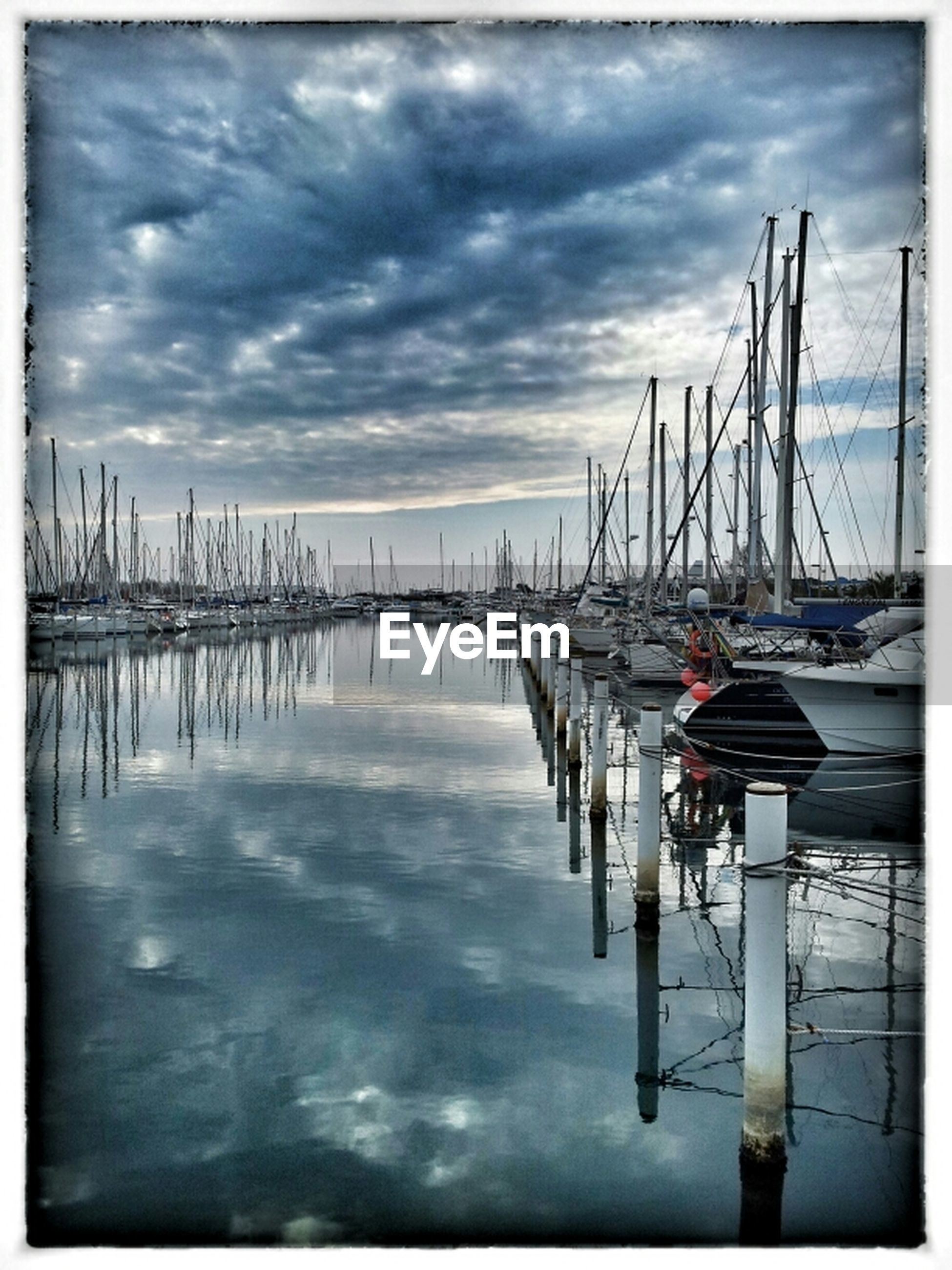 water, sky, nautical vessel, sea, transfer print, moored, transportation, pier, harbor, auto post production filter, boat, cloud - sky, mode of transport, tranquility, tranquil scene, wooden post, cloud, nature, cloudy, reflection