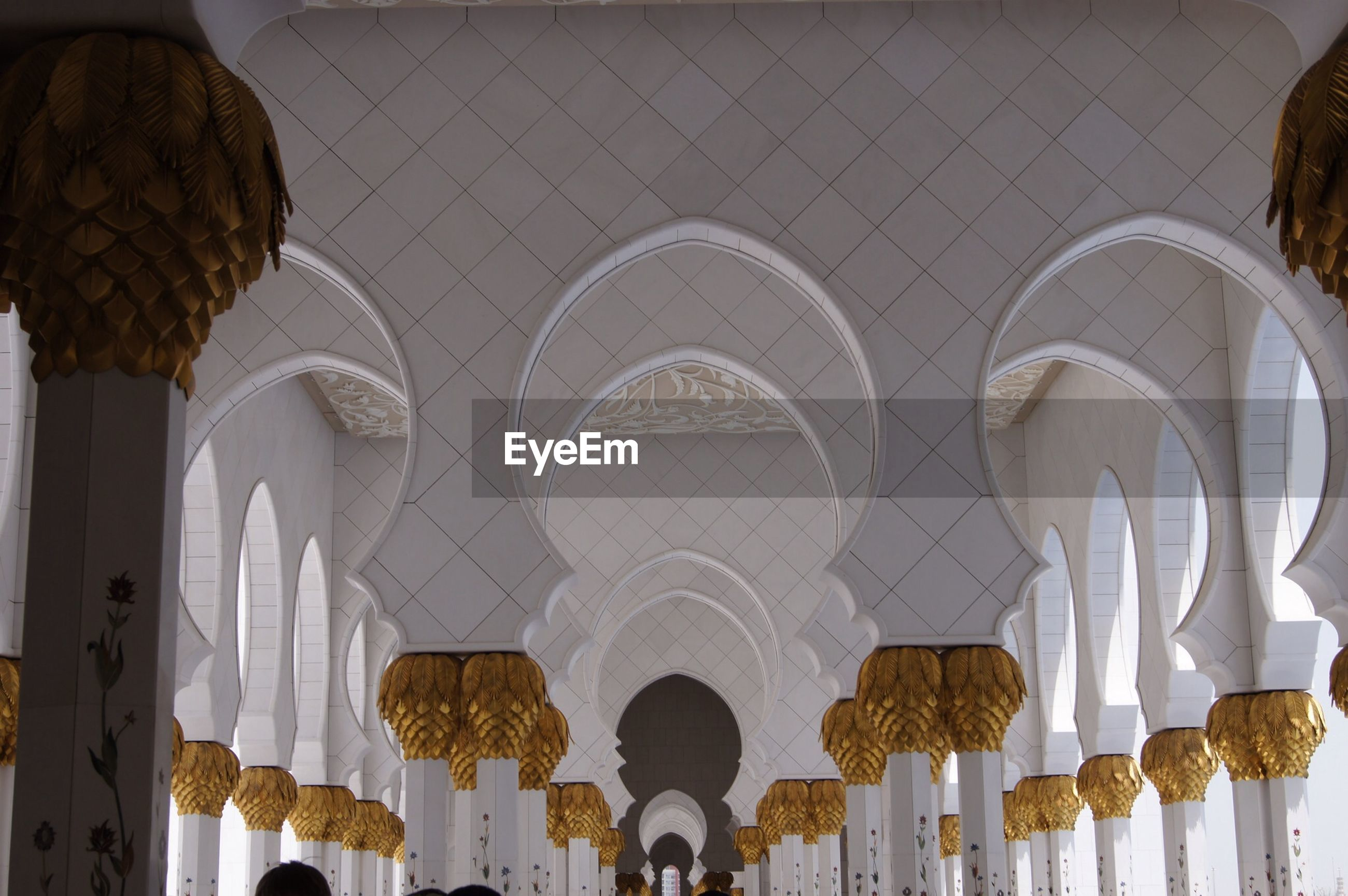 architecture, built structure, in a row, indoors, arch, architectural column, famous place, low angle view, place of worship, religion, travel destinations, building exterior, repetition, design, islam, tourism, architectural feature, spirituality, ceiling, pattern