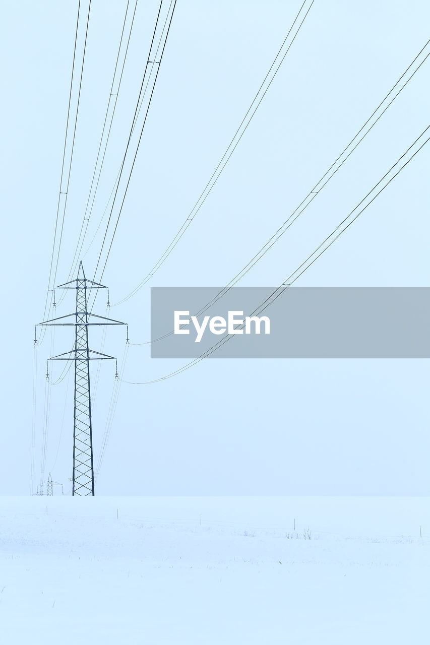 cable, electricity, snow, power line, cold temperature, winter, electricity pylon, sky, fuel and power generation, power supply, technology, nature, connection, no people, scenics - nature, environment, landscape, beauty in nature, land, outdoors, electrical equipment, telephone line