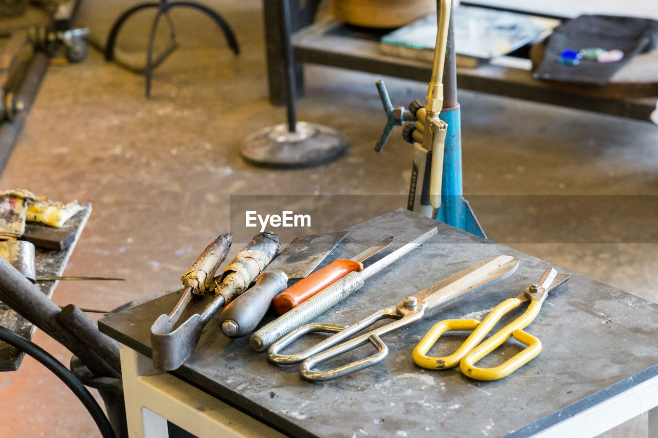 Close-Up Of Hand Tools On Table