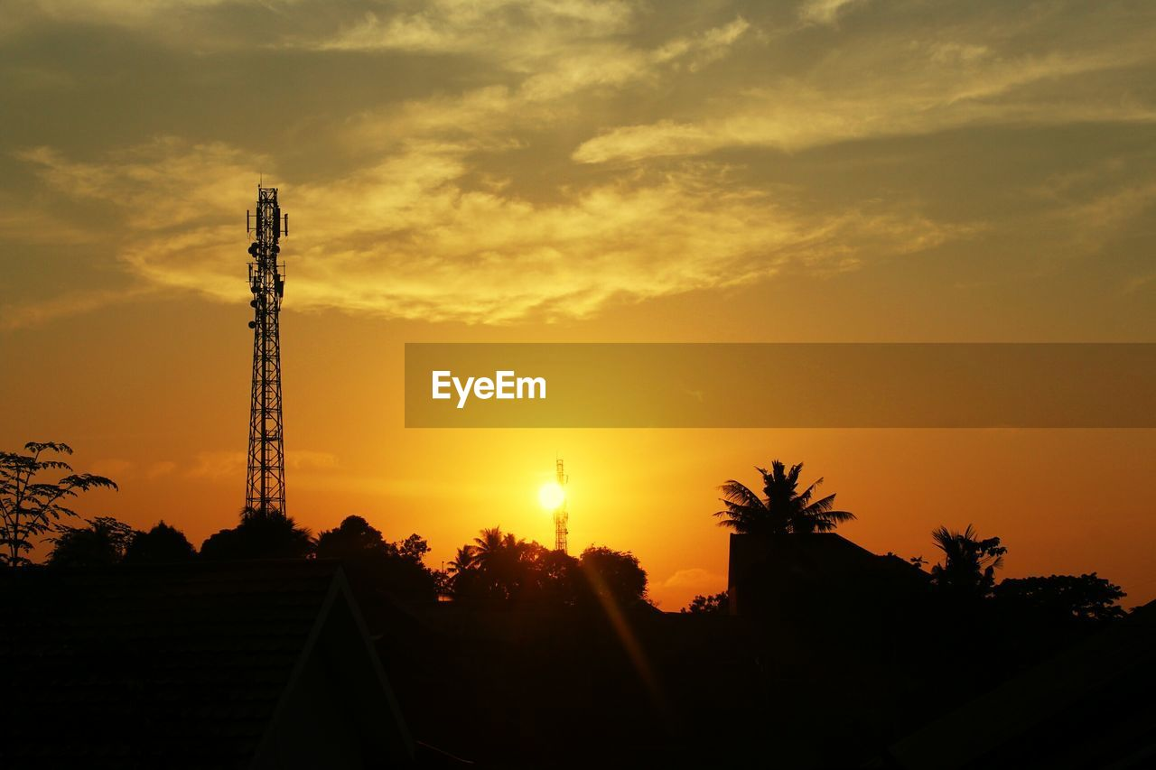 sunset, sky, silhouette, orange color, built structure, architecture, cloud - sky, beauty in nature, nature, tower, no people, tree, technology, plant, sun, outdoors, industry, low angle view, scenics - nature, building exterior, global communications, power supply