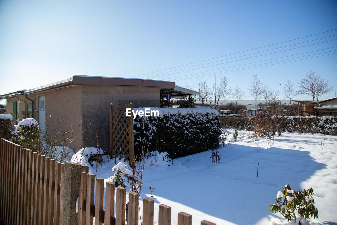BUILDINGS AGAINST CLEAR SKY DURING WINTER SEASON