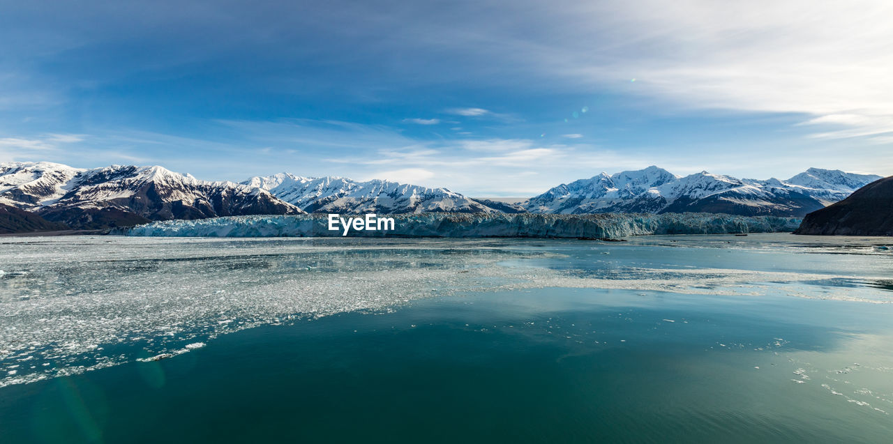 cold temperature, beauty in nature, water, winter, scenics - nature, tranquil scene, mountain, waterfront, tranquility, sky, cloud - sky, ice, mountain range, nature, idyllic, snow, glacier, environment, no people, snowcapped mountain, outdoors, iceberg, view into land