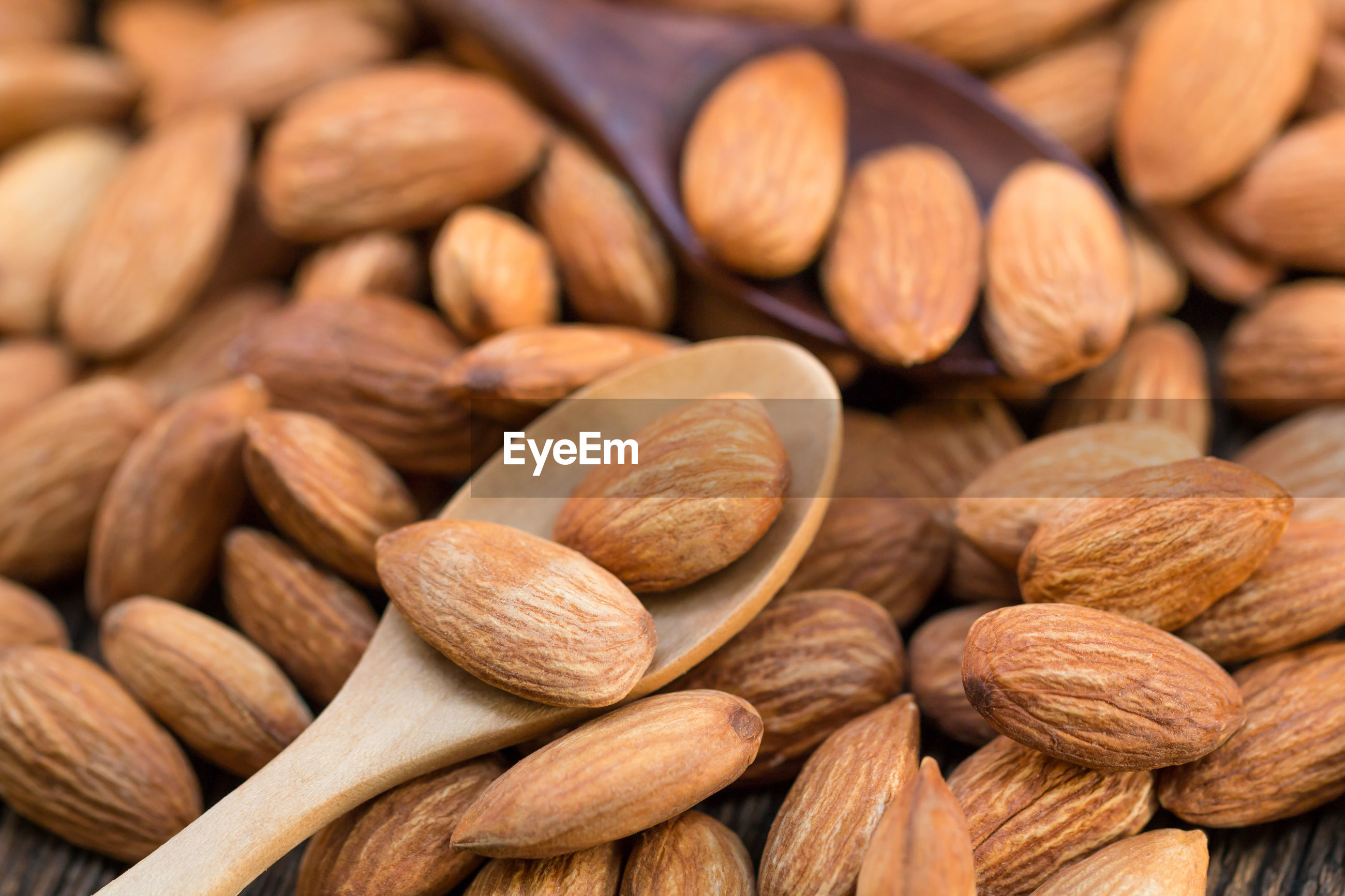 Close-up of almonds with spoon on table