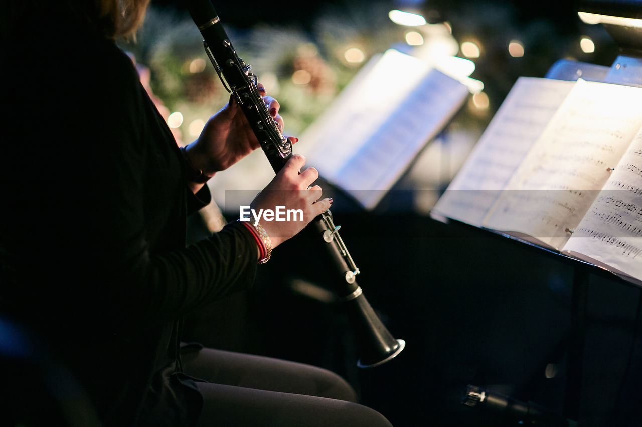 Midsection Of Man Playing Wind Instrument