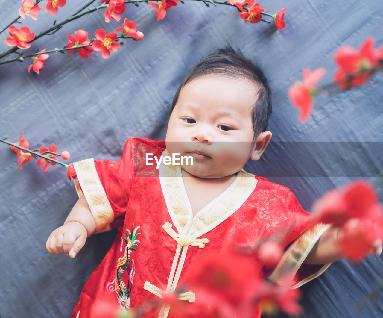 Portrait Of Cute Baby Girl Wearing Traditional Red Clothing