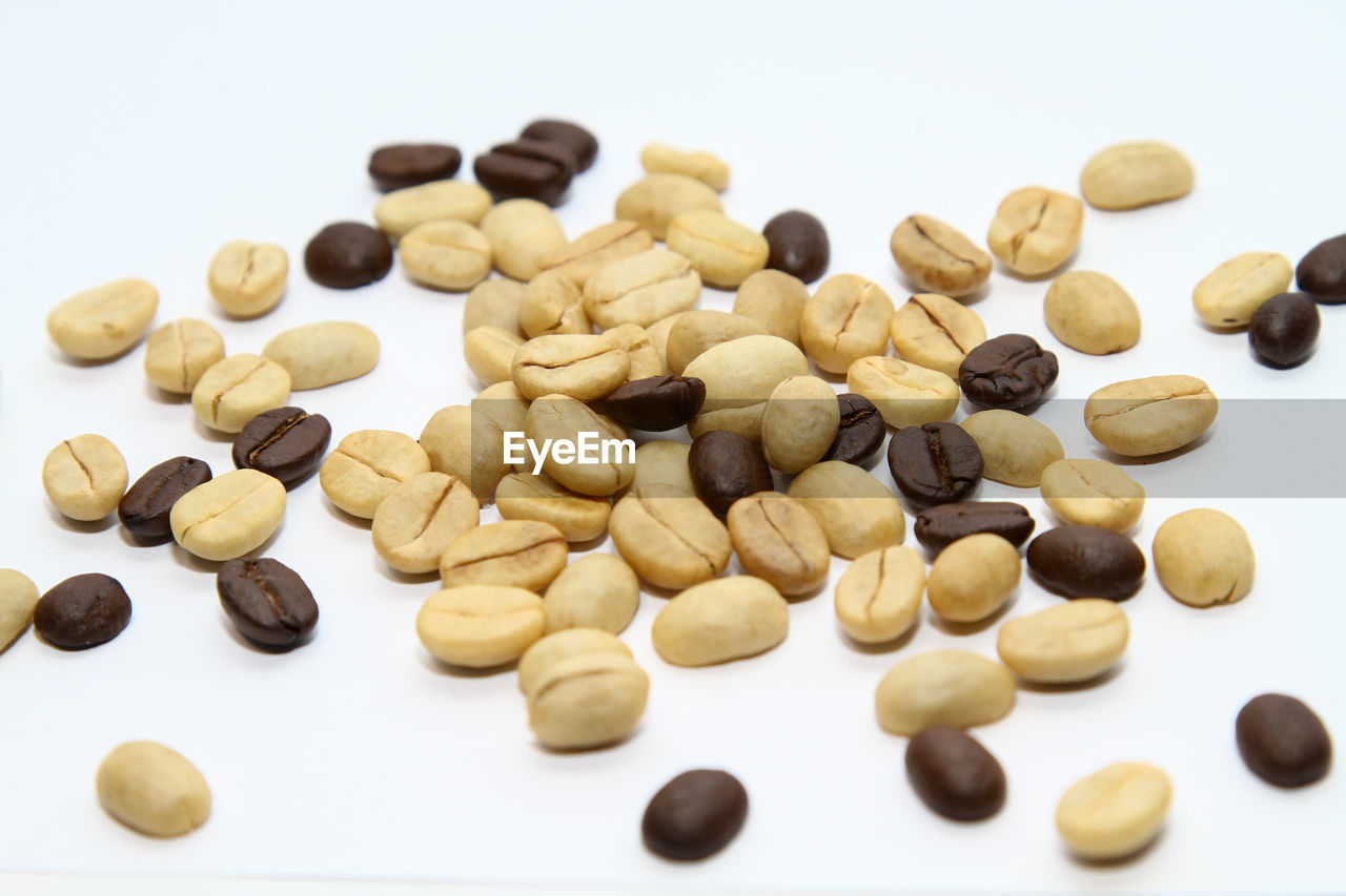 white background, studio shot, large group of objects, indoors, food, close-up, food and drink, still life, no people, freshness, wellbeing, selective focus, brown, nut, cut out, healthy eating, abundance, nut - food, high angle view, heap, snack, temptation, vegetarian food