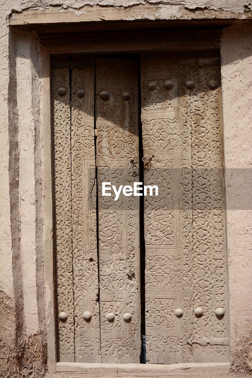 architecture, built structure, building exterior, building, craft, no people, day, wall - building feature, door, the past, history, entrance, old, ancient, bas relief, art and craft, carving - craft product, wood - material, close-up, outdoors, architectural column, ornate, ancient civilization