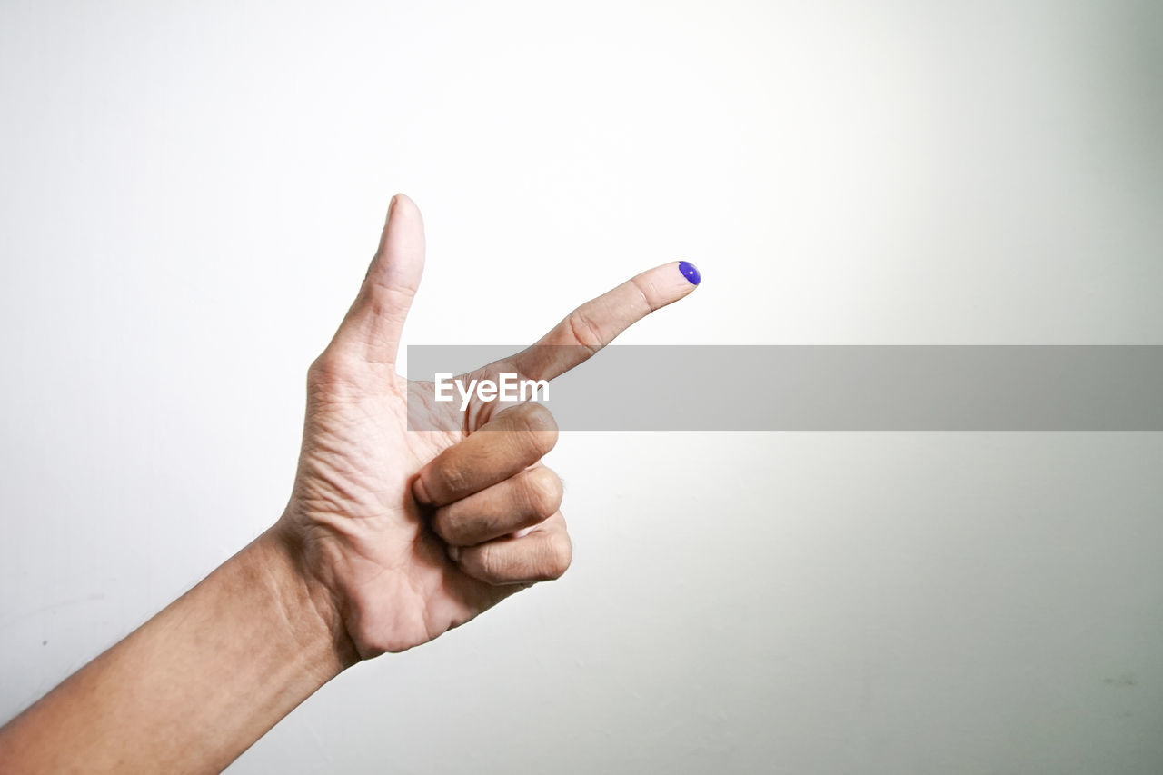 human hand, hand, human body part, one person, studio shot, white background, indoors, body part, human finger, finger, copy space, gesturing, unrecognizable person, showing, close-up, real people, communication, lifestyles, hand sign, human limb