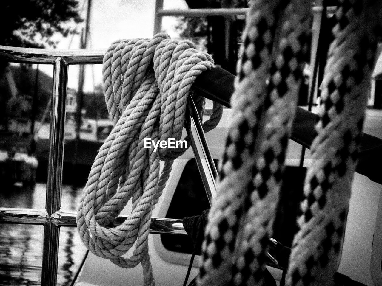 Close-up of rope tied on railing in sailboat