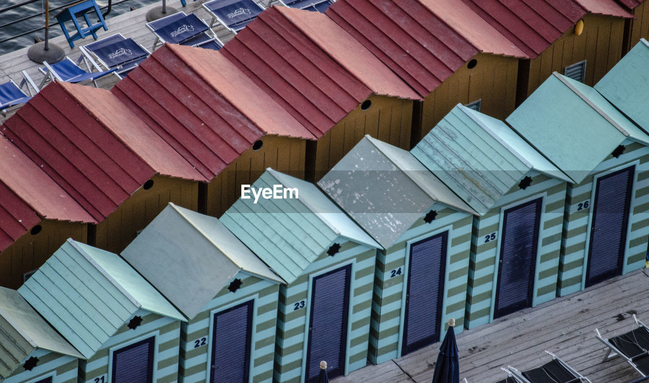 LOW ANGLE VIEW OF ROOF TILES AND BUILDING