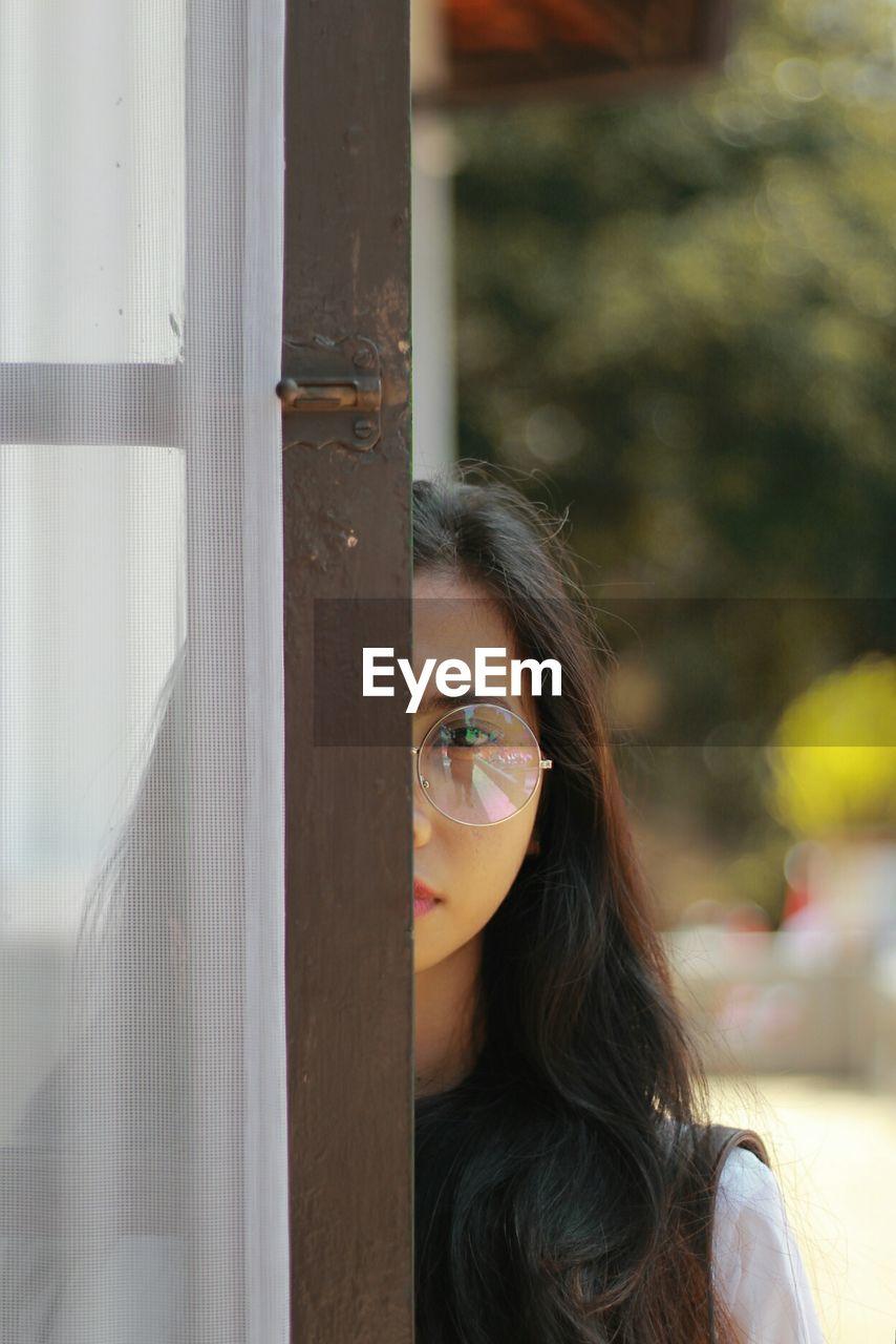 Portrait of woman by door