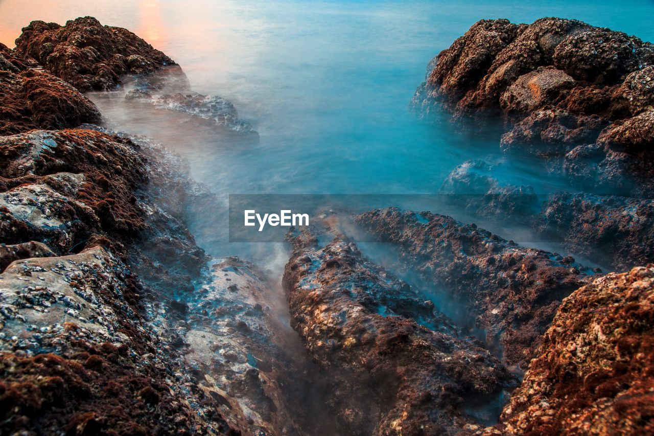 water, rock, solid, rock - object, beauty in nature, scenics - nature, sea, no people, nature, land, tranquility, day, motion, rock formation, tranquil scene, outdoors, long exposure, environment, blurred motion, power in nature