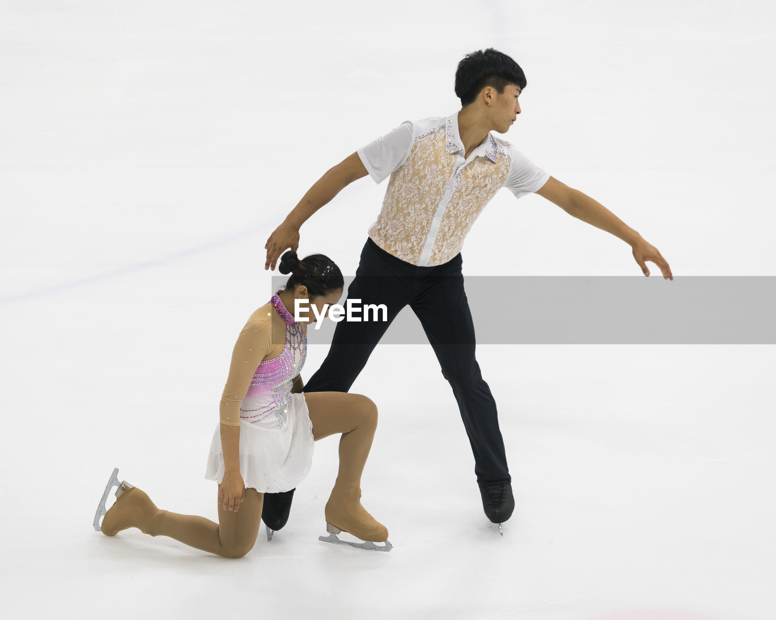 full length, white background, dancing, young adult, studio shot, lifestyles, young men, real people, two people, ballet dancer, posing, ballet, dancer, skill, young women, leisure activity, performance, jumping, standing, togetherness, energetic, day
