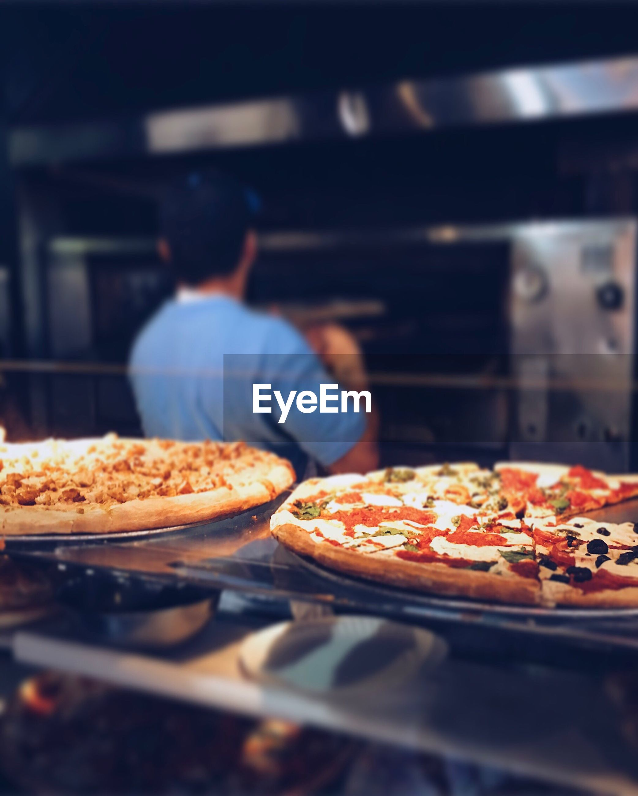 Close-up of pizza at commercial kitchen